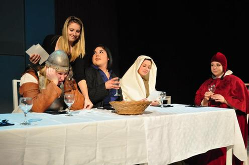 Historic characters dine at table