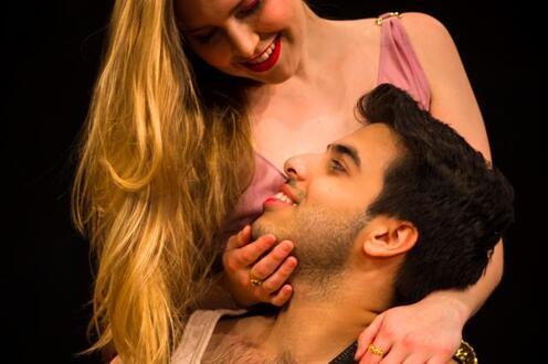 Woman strokes man's face