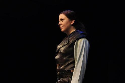 Macbeth stands with sword