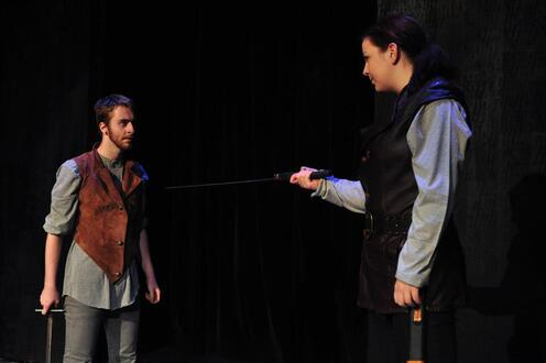 Macbeth points sword at MacDuff
