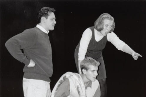 Woman in astonishment pointing out something to two other men