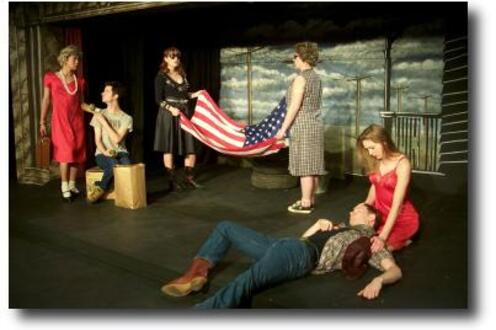 Cast of Totally Durang-ed performing on stage with one man acting dead on the ground