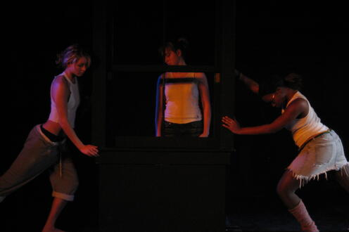 Man standing between two women in the play 'New Directions'