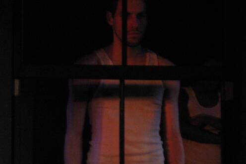 Man standing behind bars
