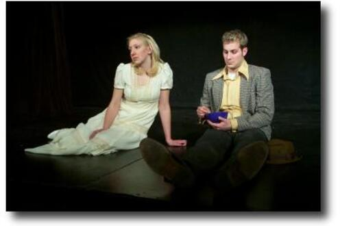 Man and a woman in a dress sitting on the ground