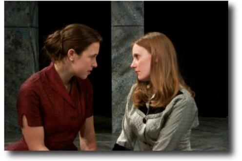 Two women in The Merchant of Venice looking at each other