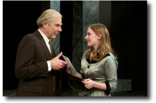 Young woman handing a piece of paper to an older man