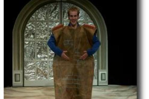 Man standing in a strange costume on stage