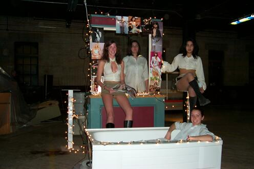 Four girls standing on set