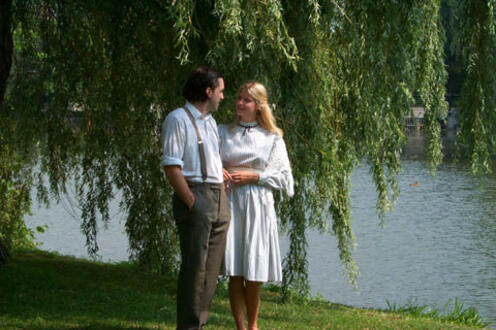 Man and woman standing by a river