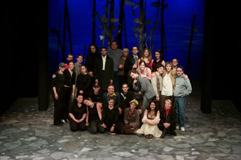 Cast of As You Like It posing for a photo on stage