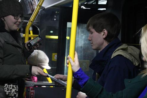 People stand on bus