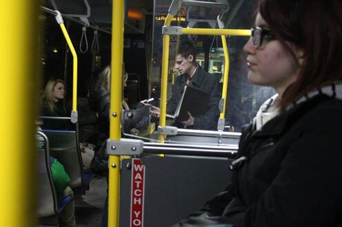 People ride bus