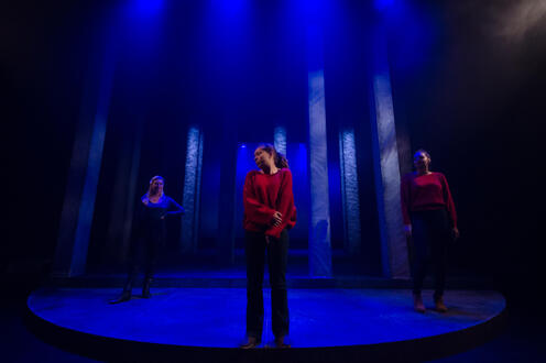 Bobbie James standing centre stage with Rosa Mundi and Nearly Wild on either side of Bobbie