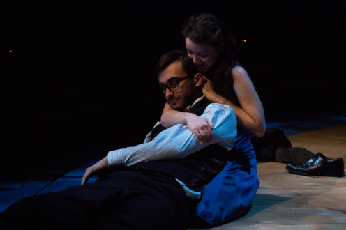 Eurydice's father lying on the ground and Eurydice is supporting him