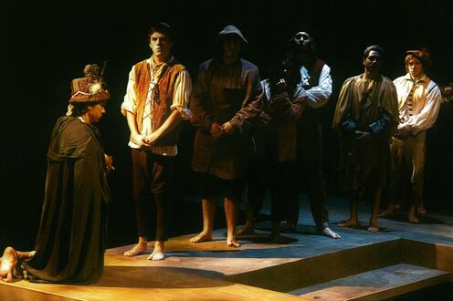 Actors standing in a line across the stage