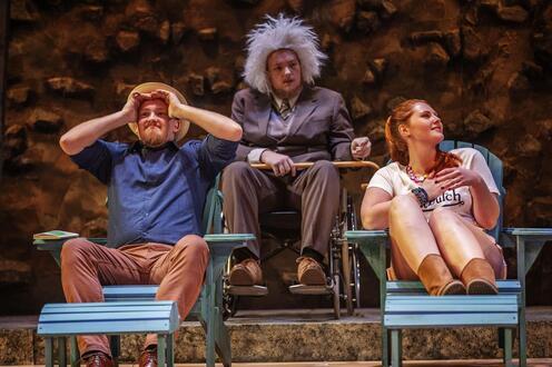 Arkadina, Sorin and Dorn sit on beach chairs