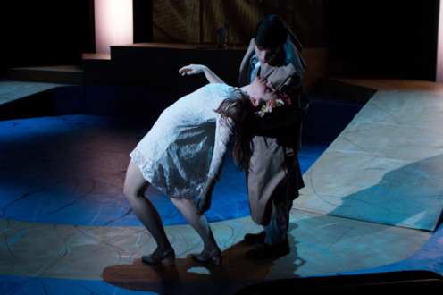 Eurydice faints and a man catches her