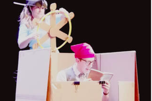 Justin and Olivia play with the boxes on stage