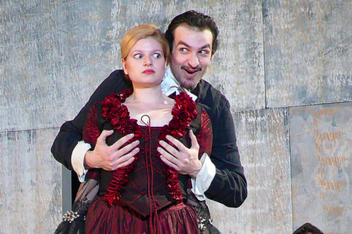 Man cupping a woman's breasts (in costumes) in the play Tartuffe