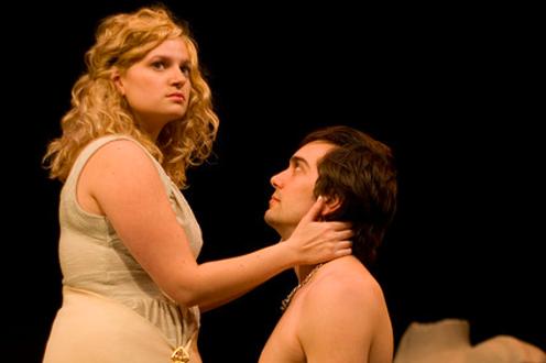 Man kneeling in front of woman in the play 'Julius Caesar'
