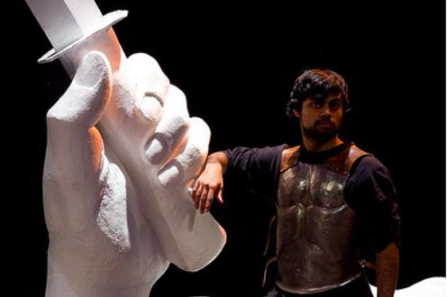 Man standing wearing armour in the play 'Julius Caesar'