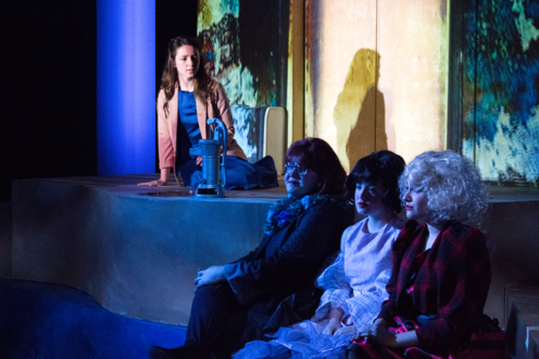 The Three Stones and Eurydice and sitting on stage