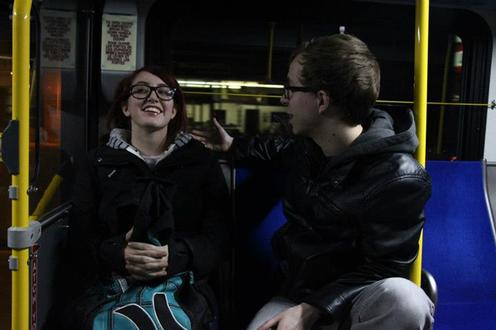 Man and woman talk on bus