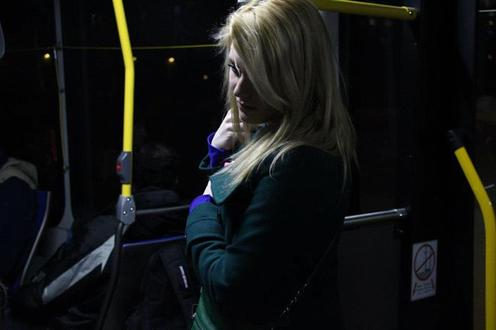 Woman stands on bus