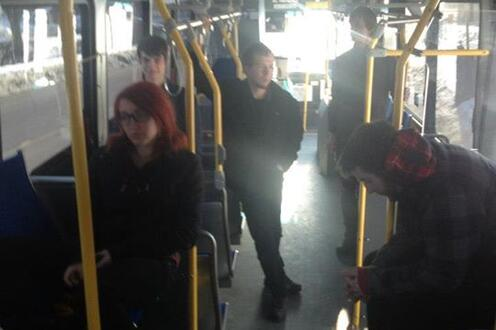 Actors stand on bus