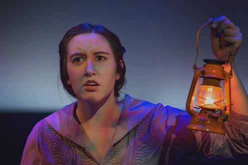 Beatrice holding a lantern