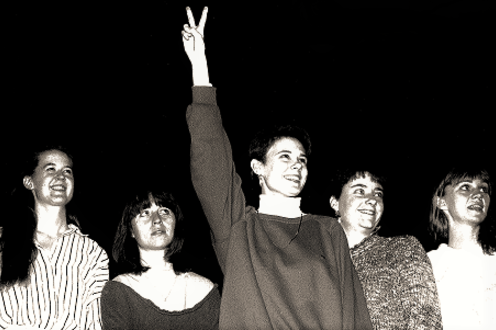 Cast together with peace hand sign in the air