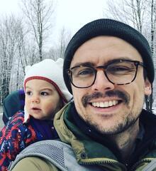 photo of David Janzen with baby