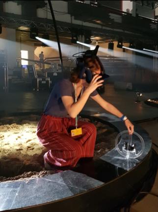 Jessica Bertrand looking through VR goggles