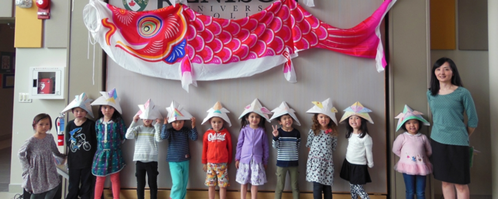 group of young students with paper hats