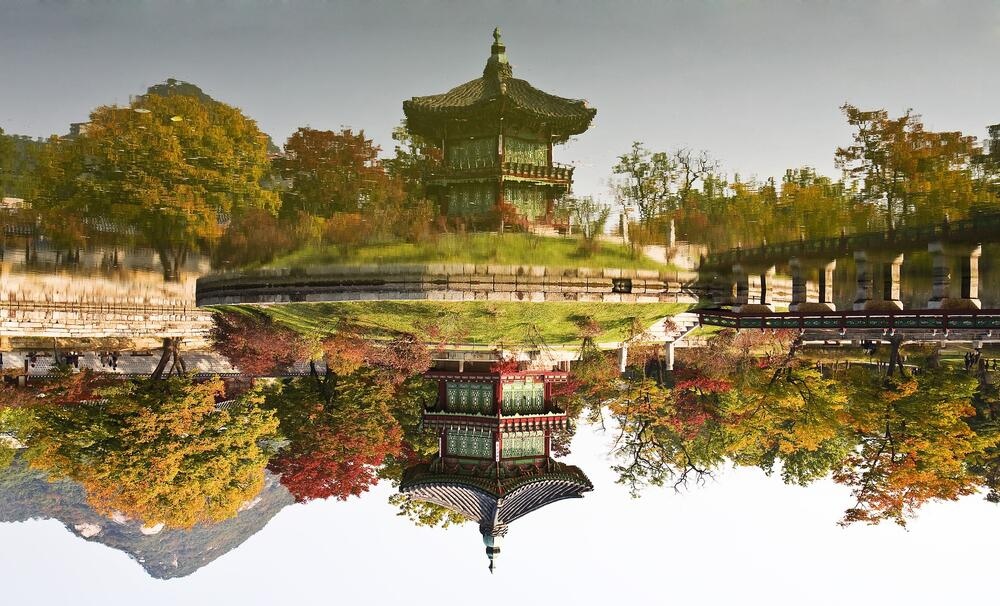 korean building plus its reflection on water