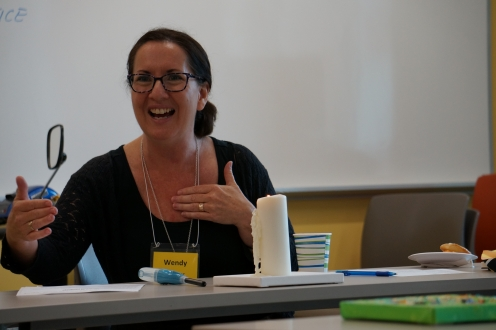 a woman speaking in a classroom
