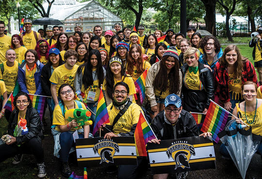 Group of Waterloo students in rainbow colours celebrating diversity at the Toronto Pride Parade