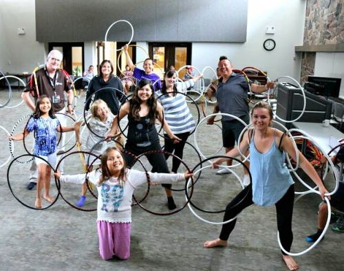 Youth participants of the Circle of Life-Long Learning camp pose with hoops