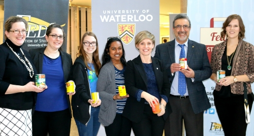 CanBuild judges holding canned food.