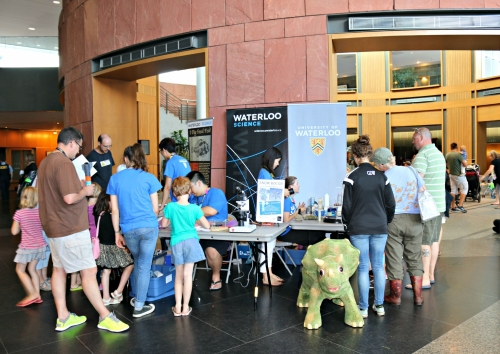 Kids and families engaging with the Waterloo Science booth at Discovery Square