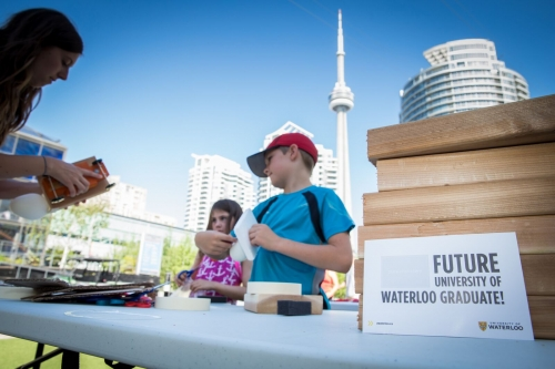 Future graudate at the ESQ booth with the CN Tower in the background