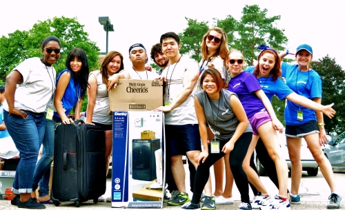 Student volunteers pose together on move-in day