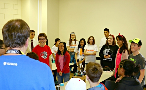 Kinds in grades 6, 7 and 8 listing to a UWaterloo volunteer at the Let's Talk Science Challenge