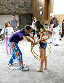 Aboriginal hoop dancer helps young girl