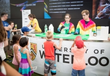 Kids at the science booth during Ontario's Celebration Zone