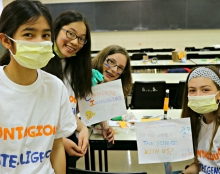 Young girls smiling at the Let's Talk Science Challenge