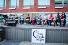 Individuals play drums at Take Back the Night