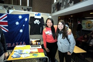 Two girls smiling in front of Australian flag