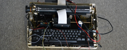 old fashioned typewriter with wires attached